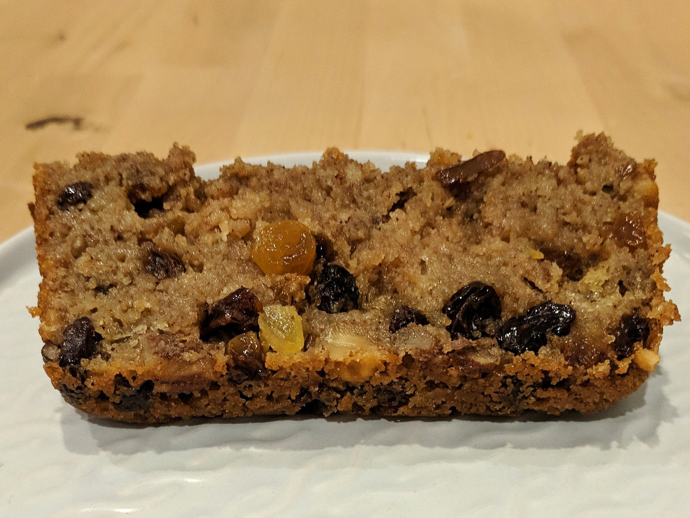 Slice of rather squishy cake, with raisins