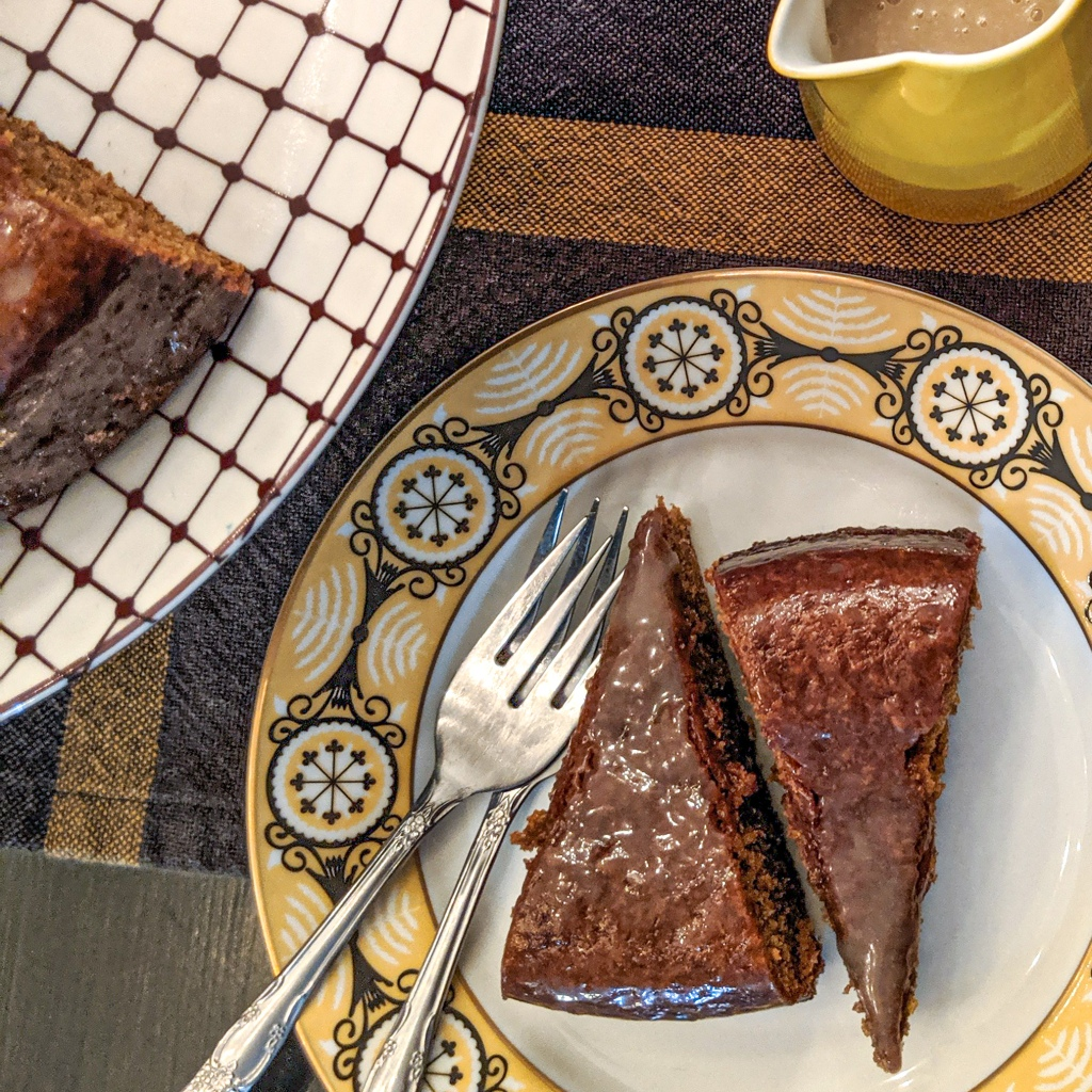 Molasses cake with sauce on the side