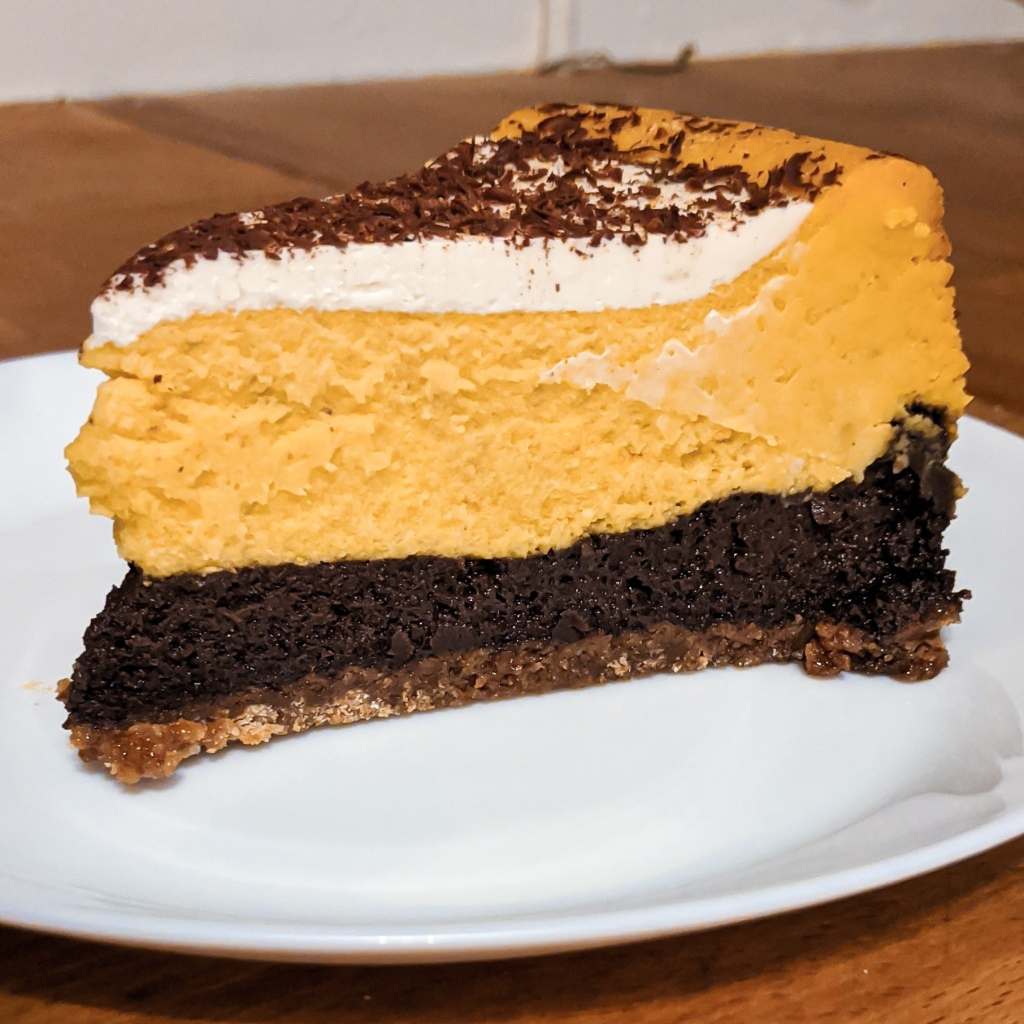 Slice of pumpkin chocolate cheesecake
