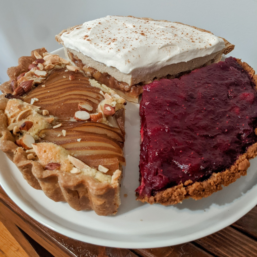 Three large slices of pie arranged on a plate like a literal pie chart.